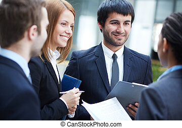 Negotiations - Group of business partners negotiating