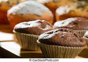 Various muffin on wooden board