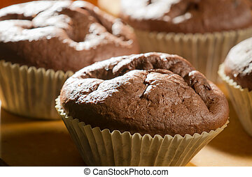 Closeup chocolate muffin in cupcake