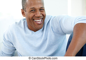 Man laughing - Image of young African man looking at camera...