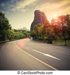 highway in sunset - highway at sunset in guilin,China