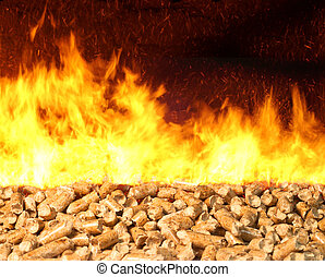 Biomass Pellet on Fire - Combustion of biomass pellets with...