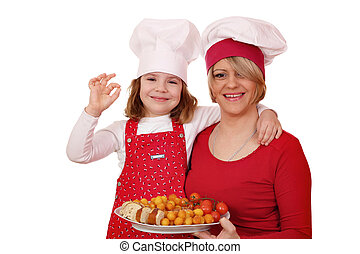 happy mother and daughter cooking