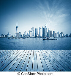 shanghai skyline and wooden floor with blue tone,beautiful...