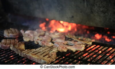 lamb chops on grill - lamb chops and t-bone steak on grill...