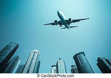 airplane with modern buildings skyline