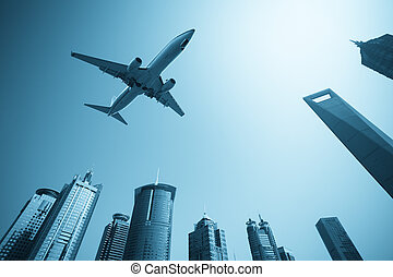 modern buildings skyline with airplane