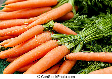 fresh orange carrots on market in summer - fresh orange...