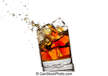 Splash in glass with whisky and ice cubes on white...