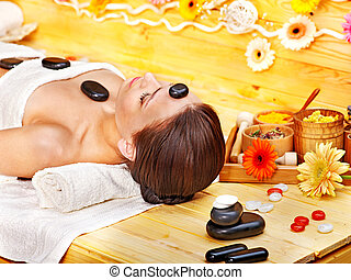 Woman getting stone therapy massage . - Woman getting stone...