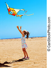 Kid flying kite outdoor. - Child flying kite beach outdoor.