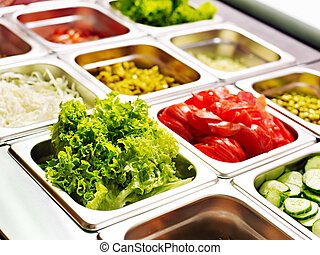 Tray with food on showcase at cafeteria - Tray with cooked...