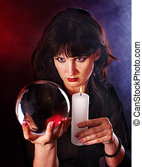 Young woman with crystal ball Fortune telling