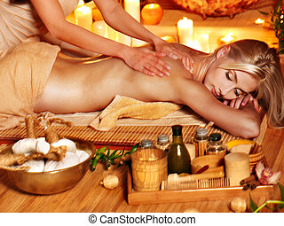 Woman getting herbal ball massage - Blond woman getting...