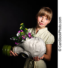 Child holding flowers and gas mask . - Little girl holding...