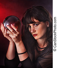 Young woman  with crystal ball. Beauty and fashion.