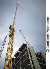 Construction cranes - Building in progress in London's...