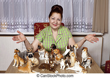 Elderly woman with a collection of porcelain figurines of...