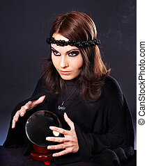 Woman with crystal ball. - Woman wearing black with crystal...