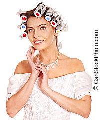 Woman wear hair curlers on head. - Woman with hair curlers...