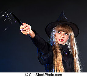 Witch girl with magic wand casting spells. - Girl in witch's...