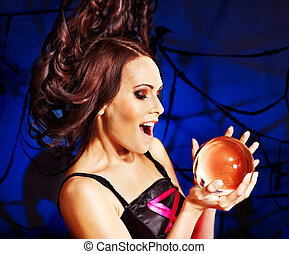 Young woman with crystal ball Halloween