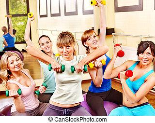 Women in aerobics class. - Group women in aerobics class.