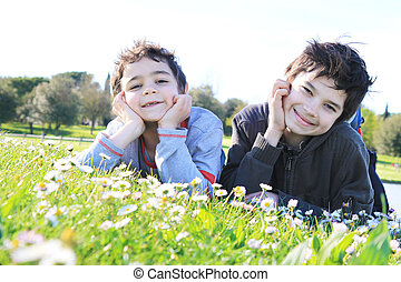 smiling brothers in the park