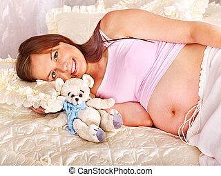 Pregnant woman holding teddy bear . - Pregnant woman holding...