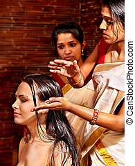 Woman having ayurveda spa treatment. - Young woman having...