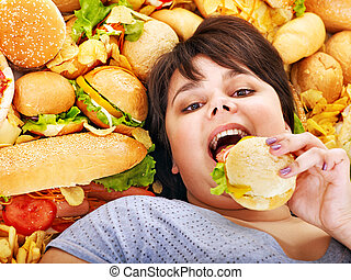Woman eating hot dog - Overweight woman holding hamburger