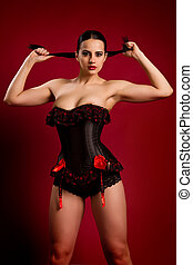 portrait of a sexy young woman in black corset - closeup...