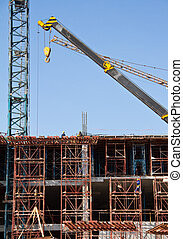 Crane construction site at thailand - Crane and workers at...