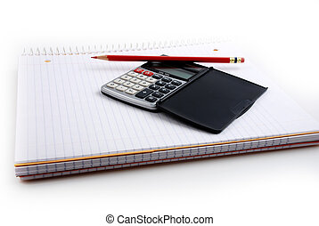 Calculating - Pictures of a calculator and glasses resting...
