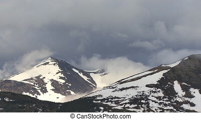 Alaskan Mountains Snow and Clouds - Alaskan mountain peaks...