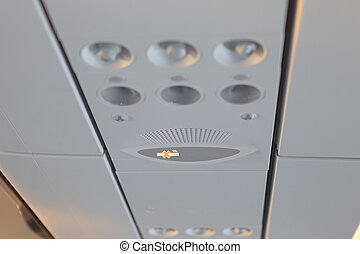 No smoking sign in airplane cabin