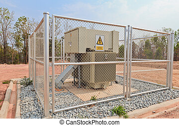 high-voltage substation in a metal fence