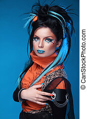 Makeup. Punk Hairstyle. Close up portrait of Rock girl with...