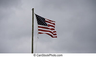 US Flag Tattered and Flapping slomo
