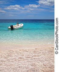 Private beach with speedboat