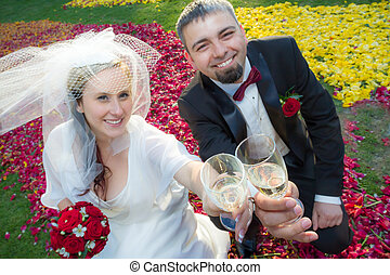 Bride and groom makes a toast with champagne