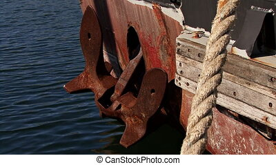 Anchor on Rode in Rusted Hull - A large rusty anchor set...