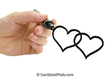 Closeup of male hand drawing two connected hearts on a virtual glass board. Over white background.