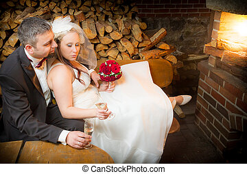 Just Married couple celebrating with champagne