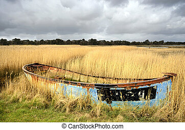 Abandoned Boat in Reeds - Rusty old shipwrecked and bandoned...