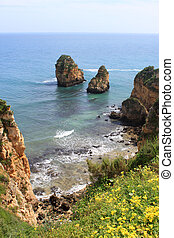 Algarve cliffs - Rocky cliffs on the coast of the Atlantic...