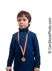 seriously little boy with gold medal at his neck isolated on...