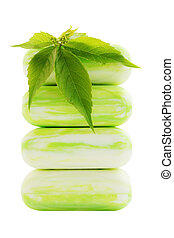 green soap - pile of green soap with leaf of wild grape