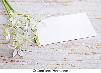 Greeting card and a bouquet of white lilies