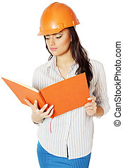 woman in construction helmet - The woman in the construction...